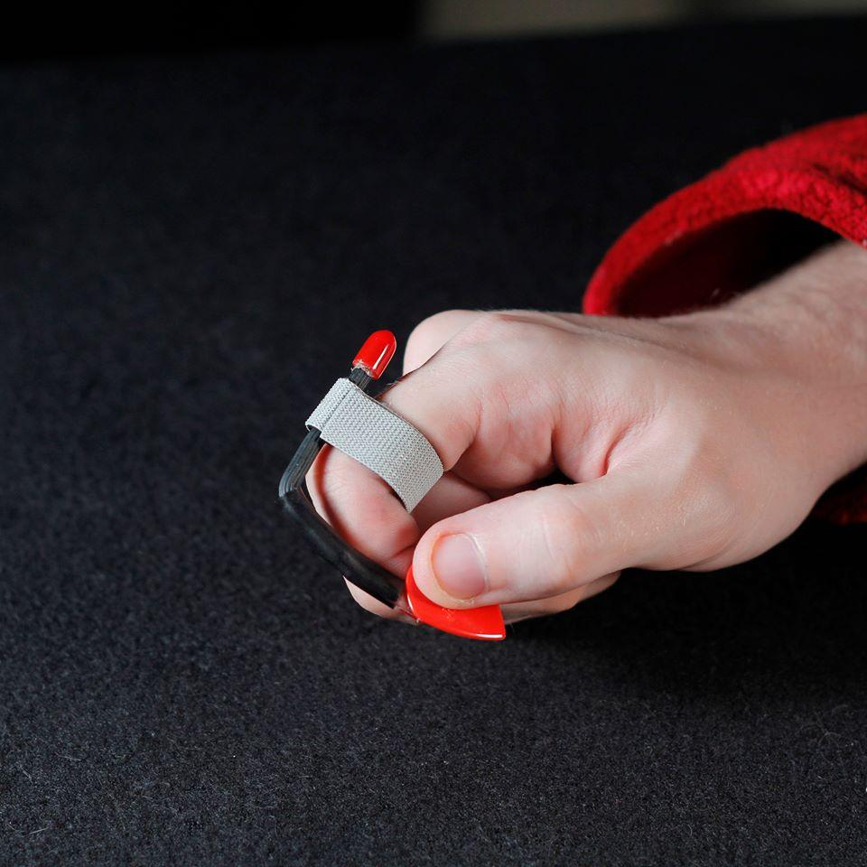 The Pick Slinger lets players grip a plectrum and then flick it out of the way when  in the mood for neck tapping or finger picking