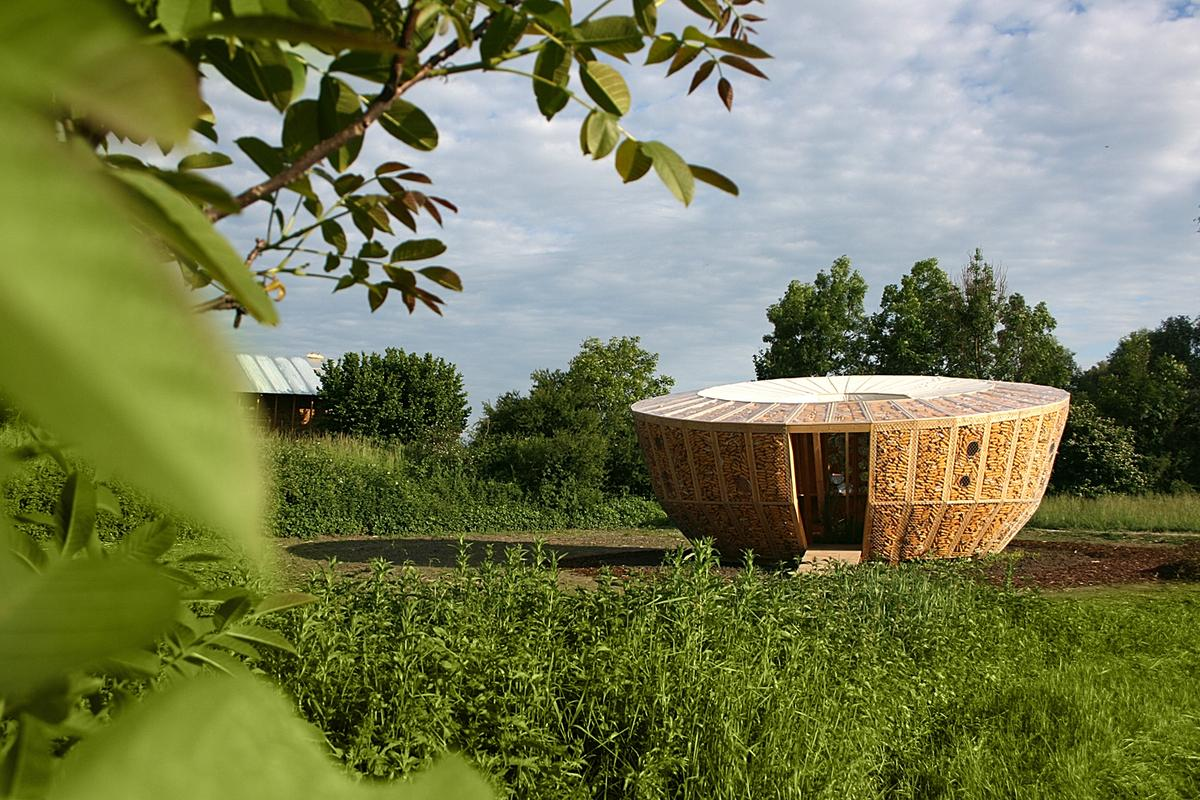 Architectural firm St André-Lang has designed and built a compact circular housing prototype that incorporates corn cobs within the walls