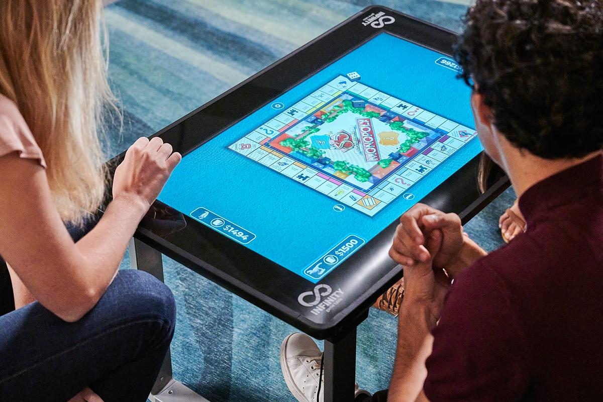 Touchscreen table packs dozens of digital board games and puzzles