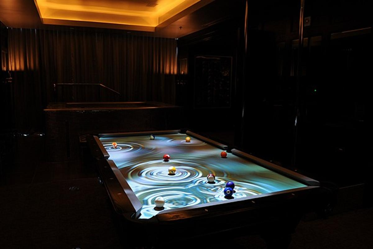The CueLight Interactive Pool Table System projects an animated display on pool tables, that follows the balls as they move