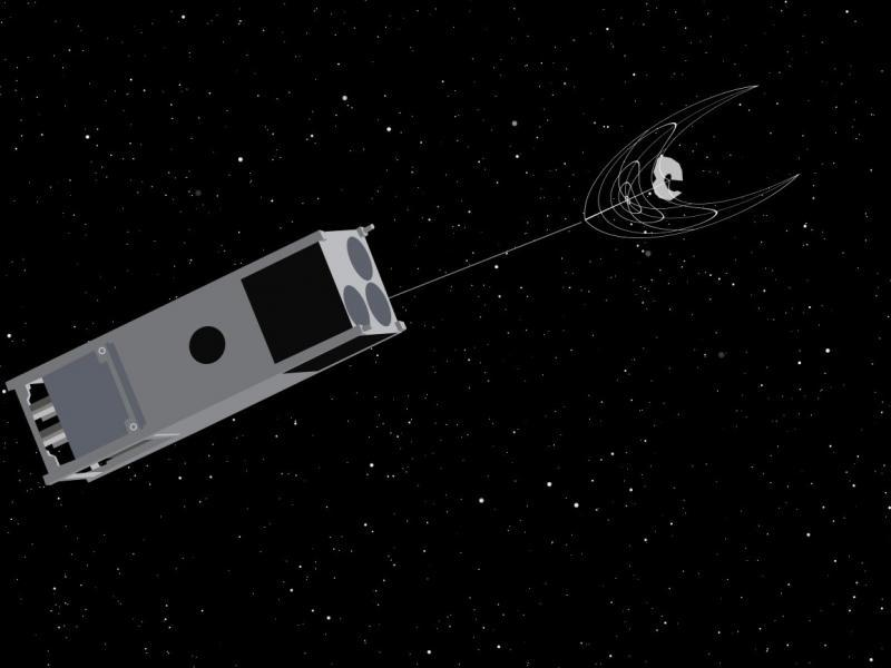 An illustration of OSCaR netting a piece of space junk