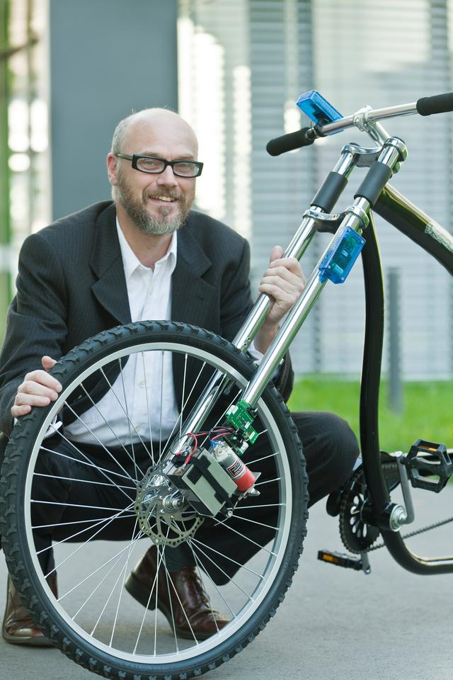 Professor Holger Hermanns with his prototype wireless bicycle braking system