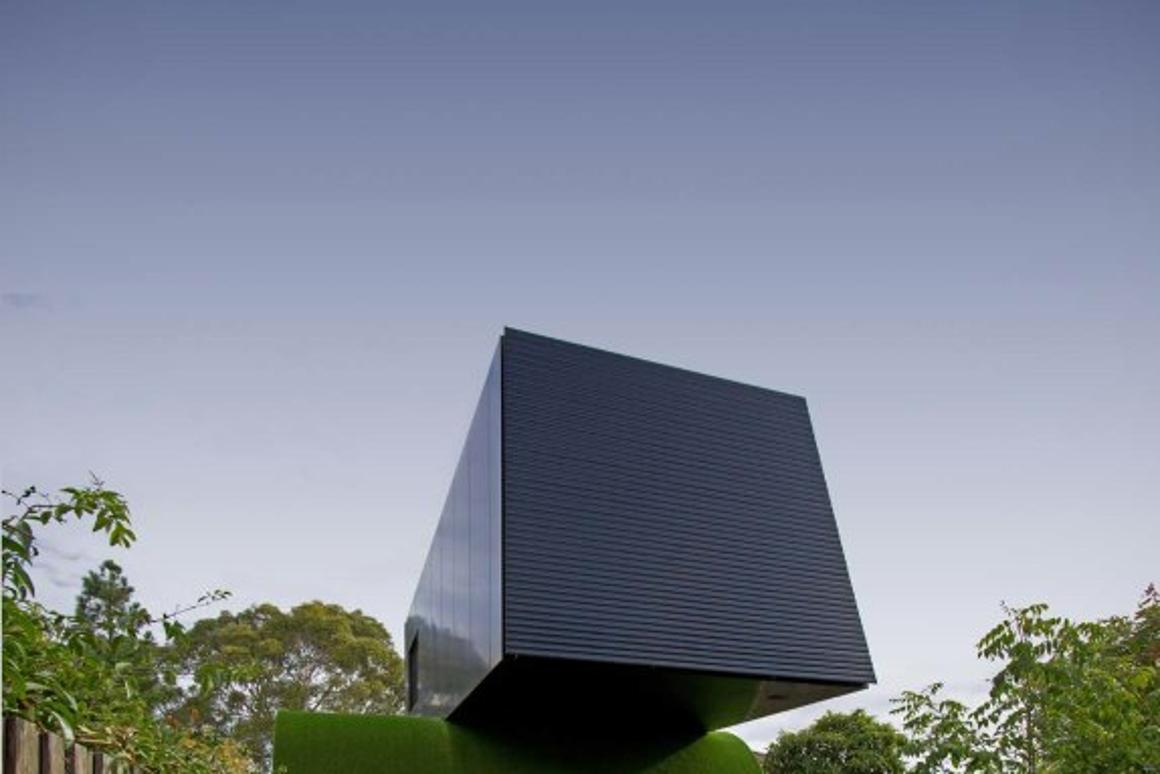 Hill House is an urban family home in Melbourne that appears as if it is riding a wave of grass