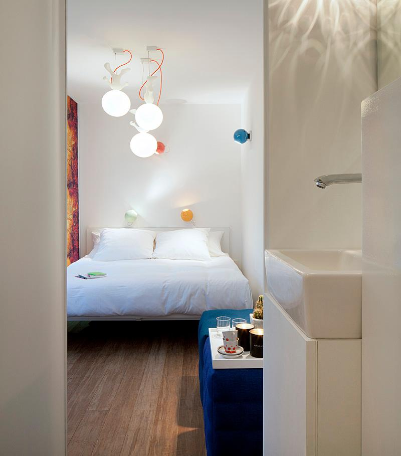 Each 20-foot long guest room has enough space for a floating box-spring bed, iPod docking station, air conditioning, and a bathroom area with a toilet and rain shower