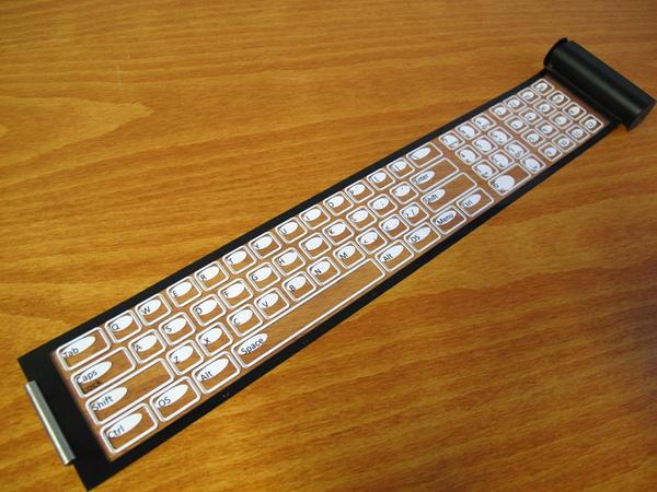 The Qii is a thin, flexible keyboard that connects wirelessly to smart devices and rolls up into a portable case about the size of a roll of coins