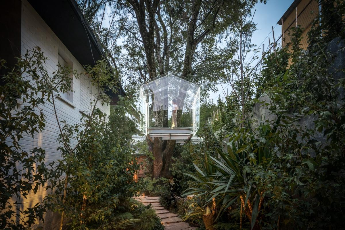 A glass treehouse mightn't be everyone's idea of a secret childhood hideaway
