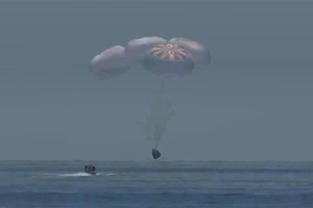 The SpaceX Crew Dragon spacecraft Endeavour splashing down