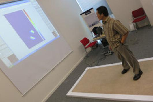 The smart carpet uses embedded plastic optical fibers and electronics to detect a person's walking patterns