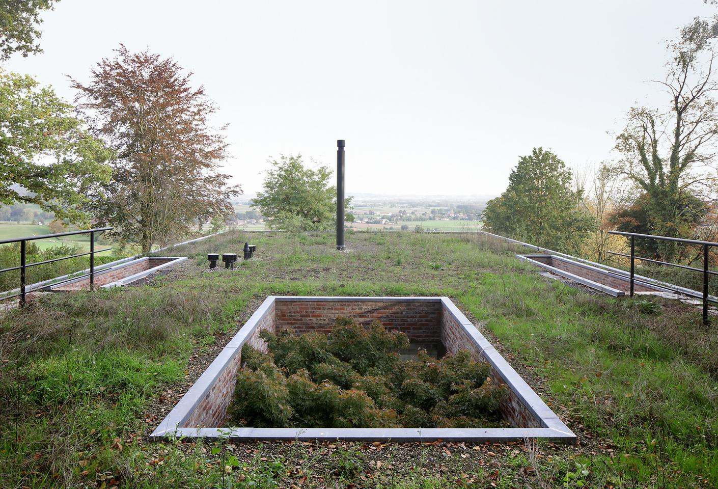 Dutch architectural firm Studio Okami has recently completed a green roof home that vanishes into its natural landscape setting