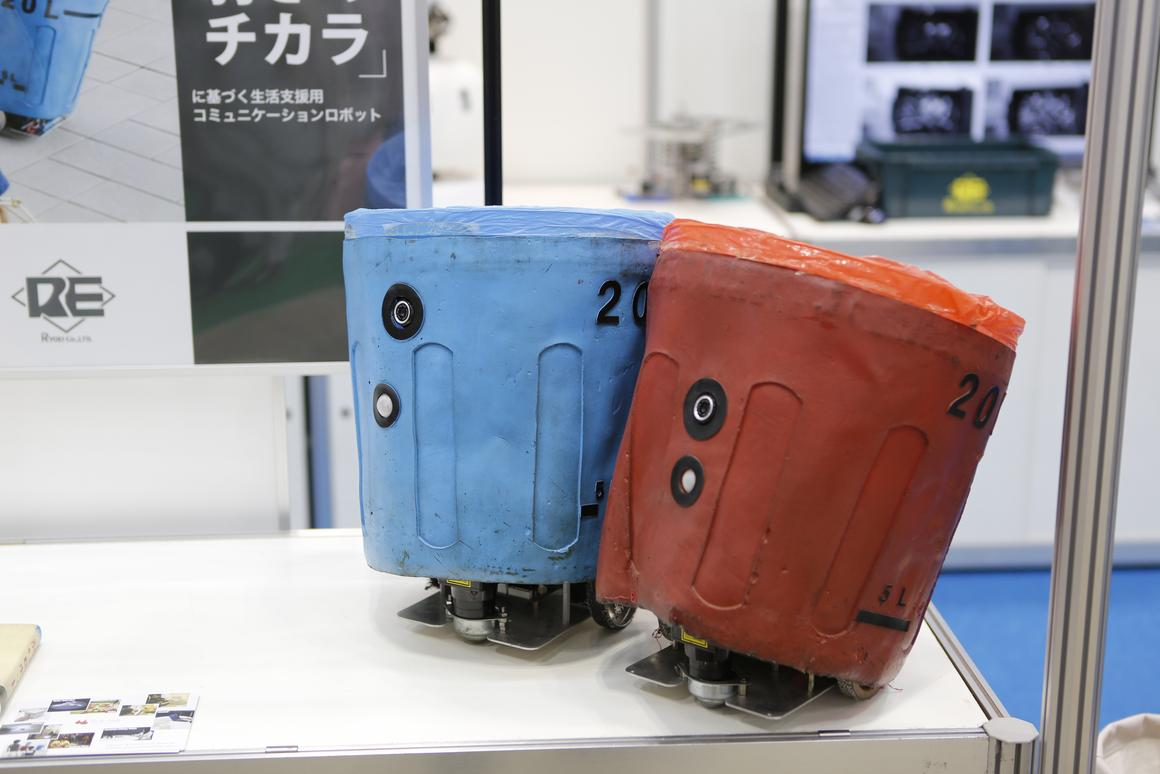 A couple of social trash box robots, on display in Tokyo at IREX 2013