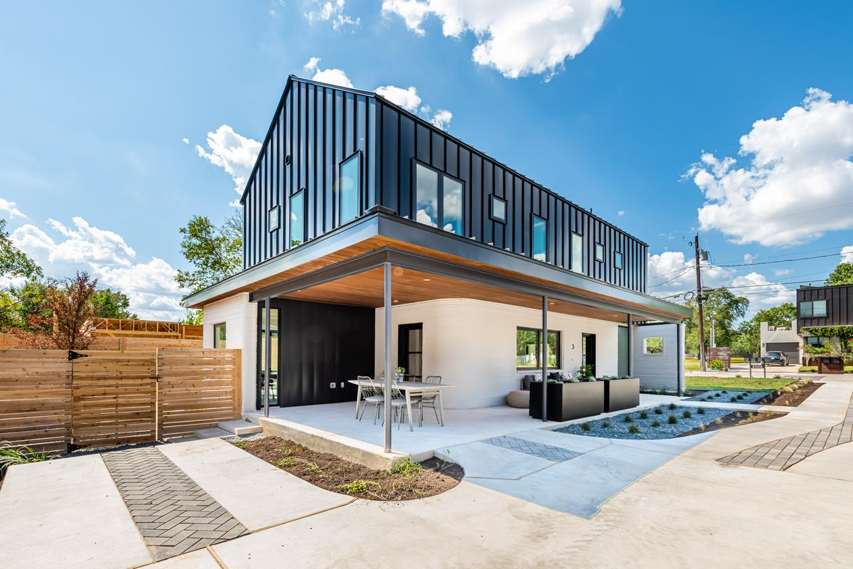 The East 17th St 3D-printed Home Development's homes consist of a 3D-printed lower floor and a timber upper floor