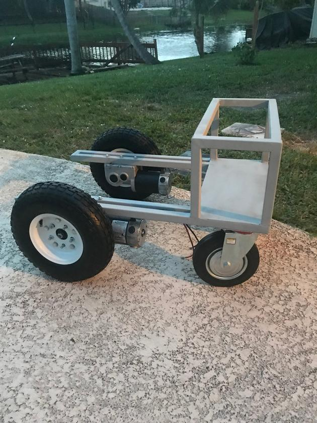 The first iteration of the Aircraft Tug has two 13-inch wheels driven by wheelchair motors