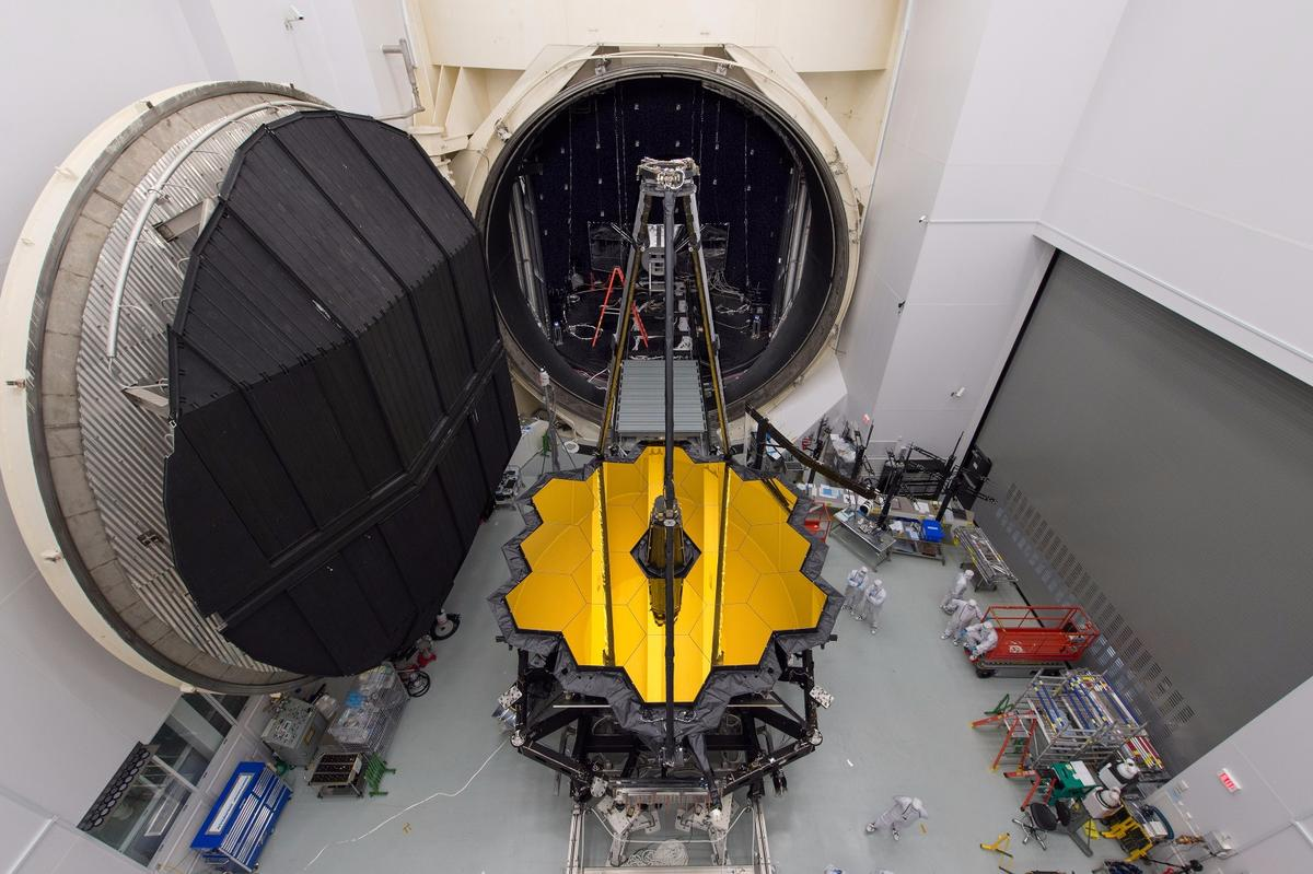 The James Webb Space Telescope sitting in front of a giant thermal–vacuum chamber in NASA's Johnson Space Center