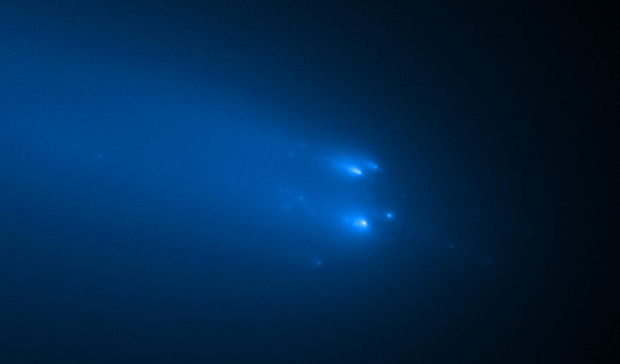 This Hubble image, taken on April 20, 2020, shows around 30 pieces of the crumbling comet C/2019 Y4 (ATLAS)