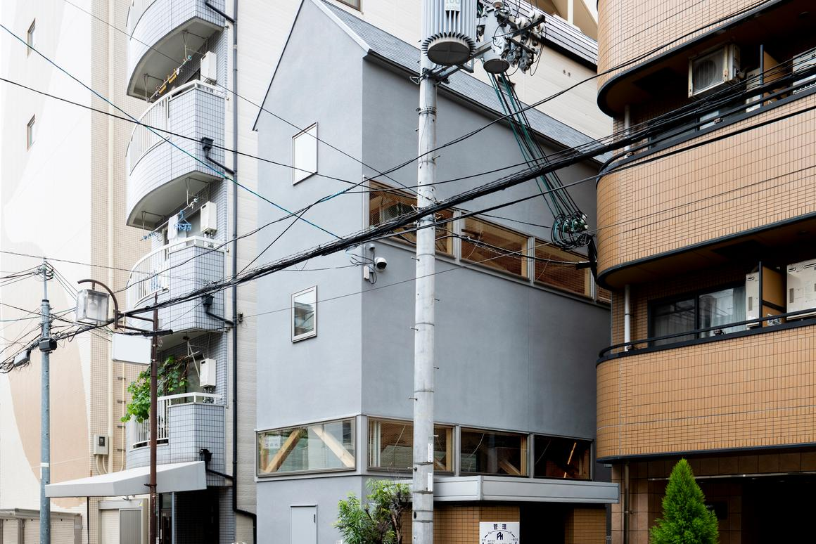 House in Osaka hosts both a home and an office in a narrow city plot