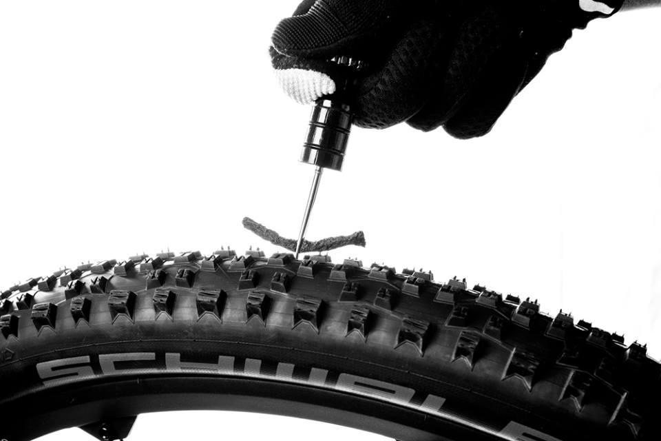The Sahmurai Sword combines an automotive-style tire patch kit with handlebar plugs