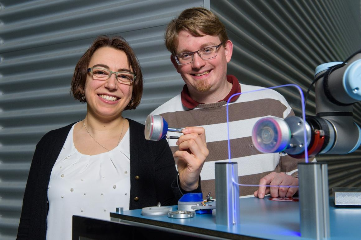 Research assistants Susanne-Marie Kirsch and Felix Welsch, with the vacuum gripper