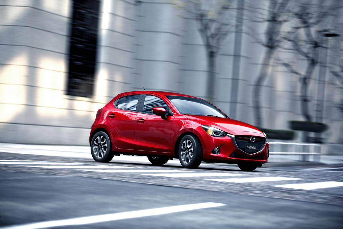 The 2016 Mazda 2 now shares the oversized grille work, angular headlights and sloping nose treatment of its larger siblings
