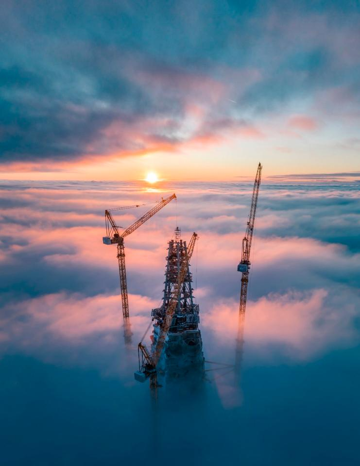 Sun rises over a skyscraper under construction in Saint Petersburg, Russia