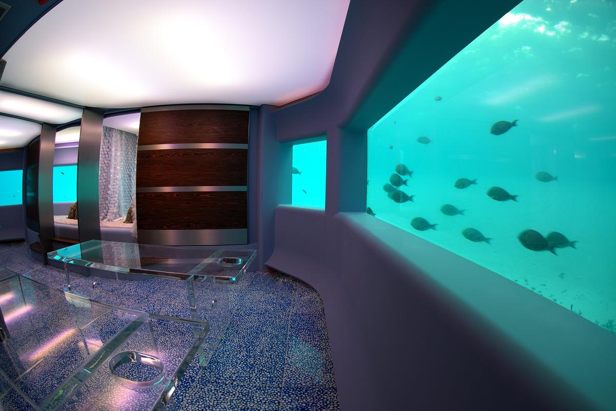 Visitors enter the submarine spa via an underwater corridor