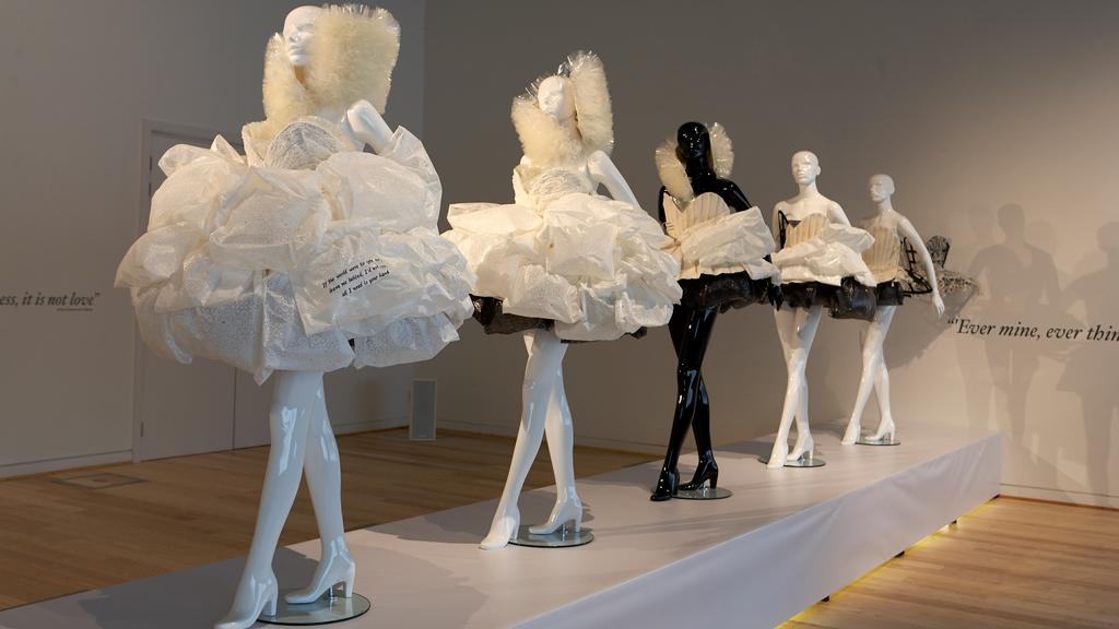 The five pieces show the transformation in stages from wedding dress to fashion garment and ultimately to dissolution