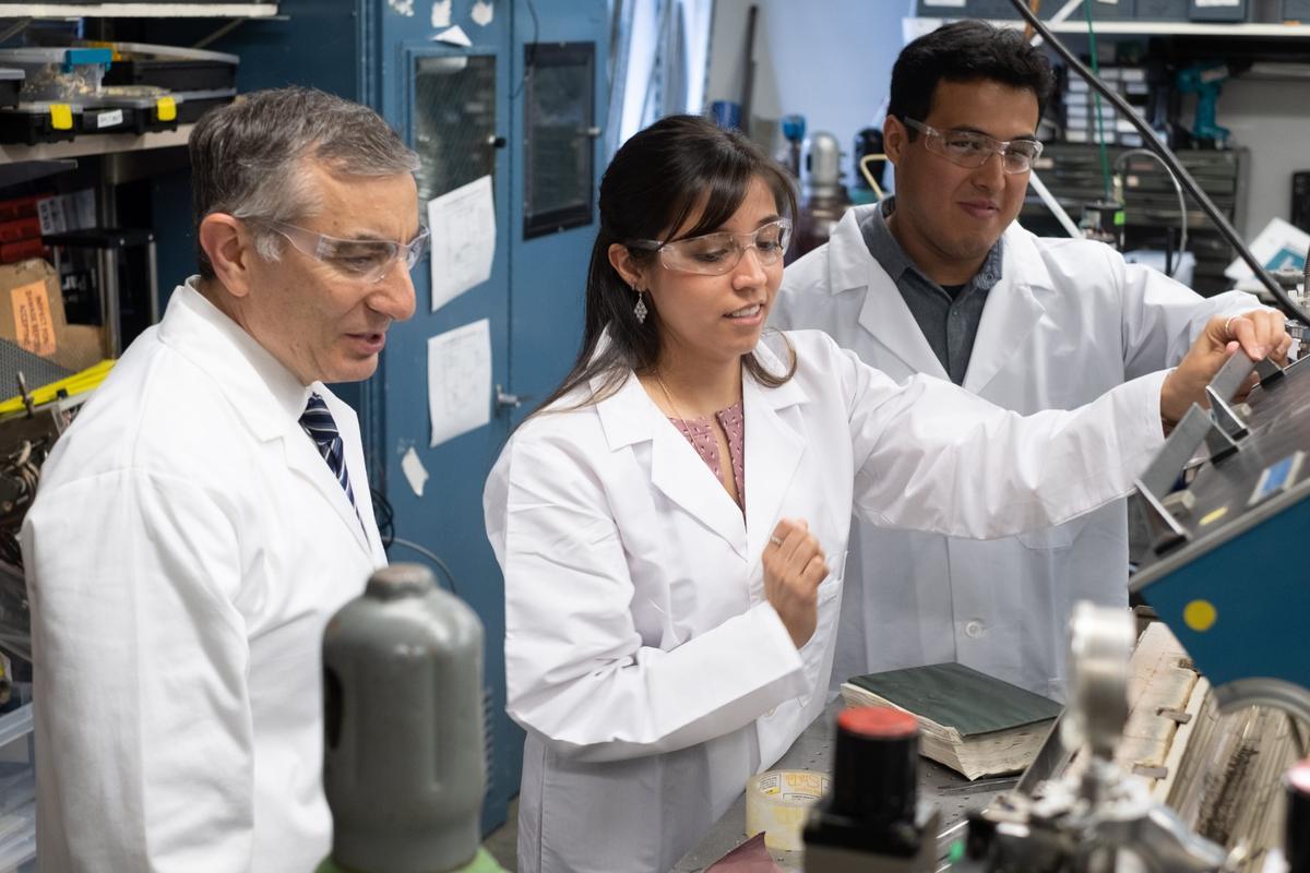 Rice University chemist James Tour, left, graduate student Gladys López-Silva and postdoctoral researcher Rodrigo Salvatierrahave come up witha new kind of battery that prevents dendrite growth