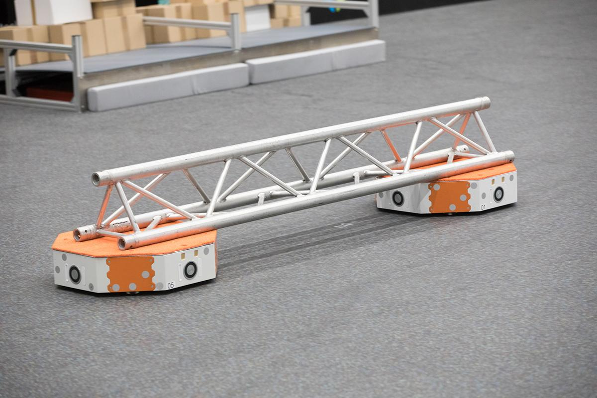 Utilizing swarm robotics technology, two LoadRunners work together to carry a girder