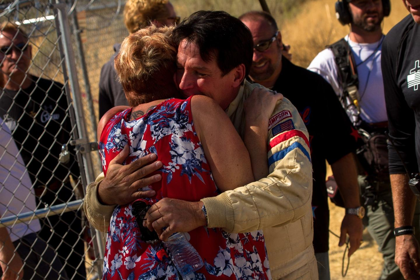 Final hugs for friends and family members before the jump