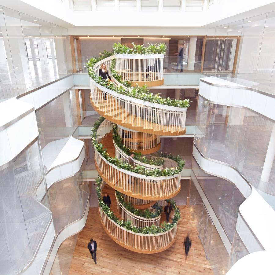 The Living Staircase is 12.5 m (41 ft) high and connects the building's four office floors
