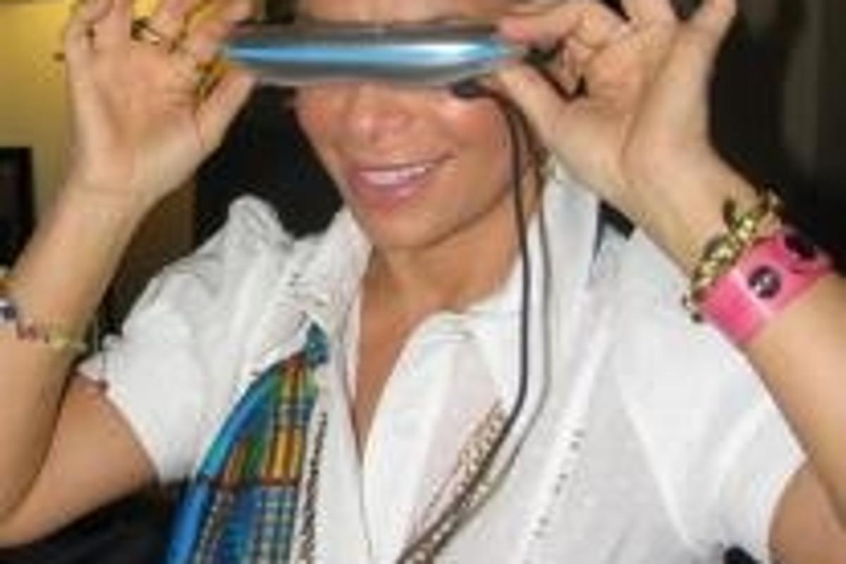 American Idol's Paula Abdul is impressed by ezGear's ezVision video glasses.
