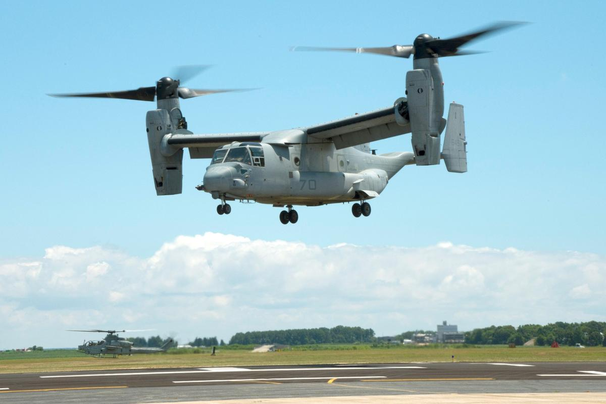 An MV-22B Osprey equipped with a 3-D printed titanium link and fitting inside an engine nacelle maintains a hover during a July 29 demonstration at Patuxent River Naval Air Station