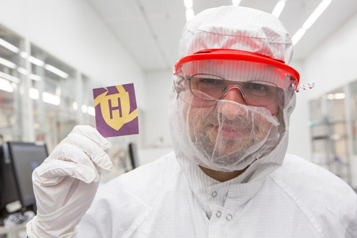 Mikhail Kats displays a piece of paper, that has been colored using the new system (Photo: Eliza Grinnell)