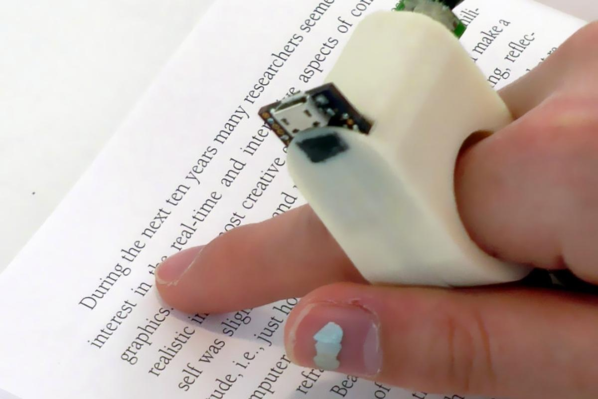 FingerReader uses a built-in camera to scan pieces of text, providing audio feedback to the visually impaired in real-time