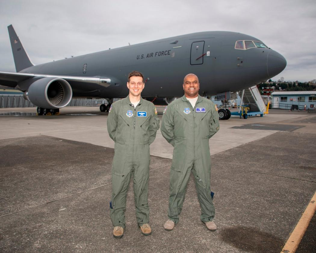 Nick Cenci, Major, USAF Chief of Flight Operations DCMA (Seattle) (left) and Anthony Mariapain, Major, USAF KC-46 Chief Pilot DCMA (Seattle) stand in front of the KC-46A Pegasus at Boeing Field in advance of the U.S. Air Force acceptance of Boeing's first tanker
