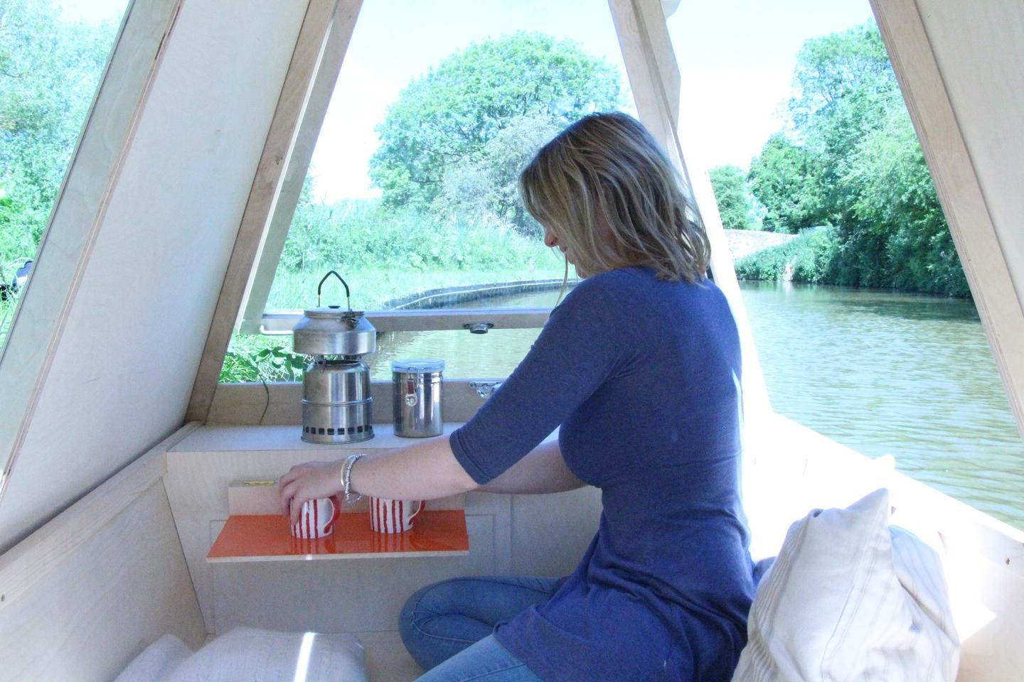The WaterBed features a fold down side table, perfect for enjoying a cup of coffee on the canal