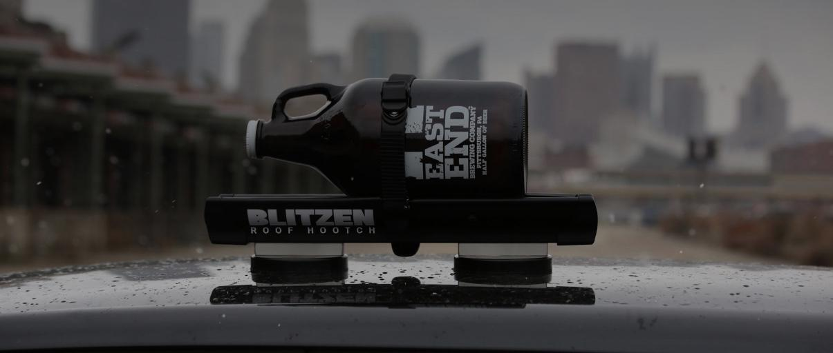 Blitzen cradles bottles of any size in an aluminum rail, holding them down using a ratcheting rubber strap