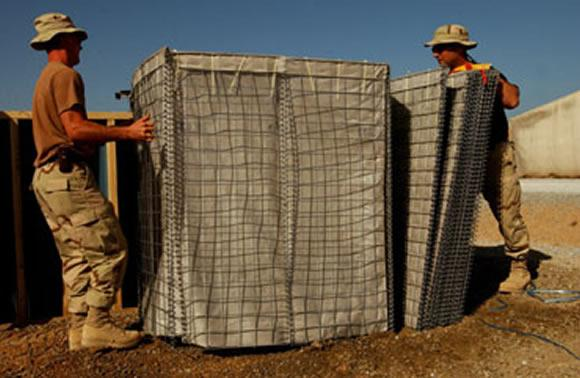 Solidiers assembling a Hesco Bastion cell