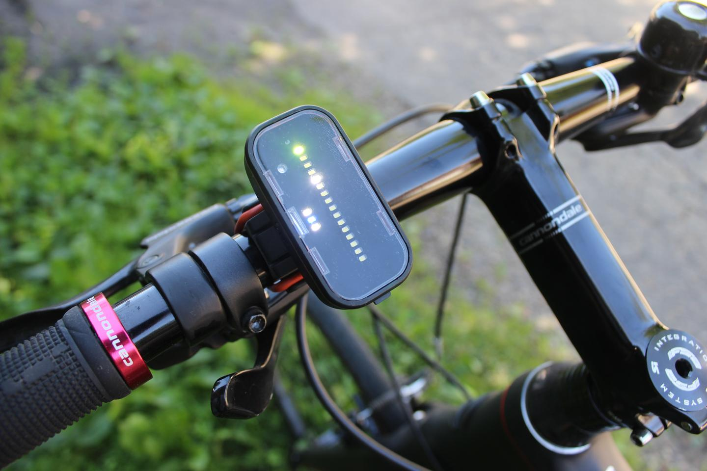 The Backtracker handlebar unit indicates the position of the cyclist (green LED at top) and the relative distance of a motorist closing in from behind (white LED)