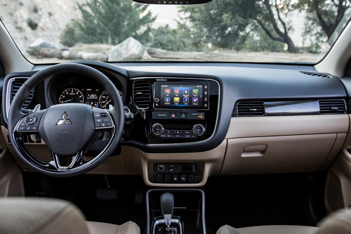 Inside the 2018 Outlander, the interior is rather plain and unadorned