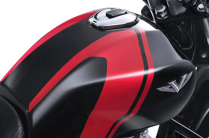 The elegant 13-liter fuel tank of the Bajaj V is made from recycled metal sourced from the INS Vicrant aircraft carrier
