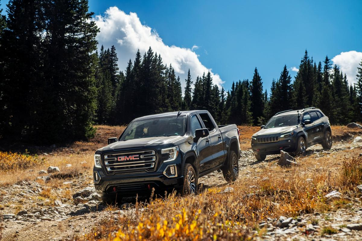 The GMC Sierra AT4 leads the way and the Jeep Cherokee Trailhawk follows close behind, ready to prove itself equal