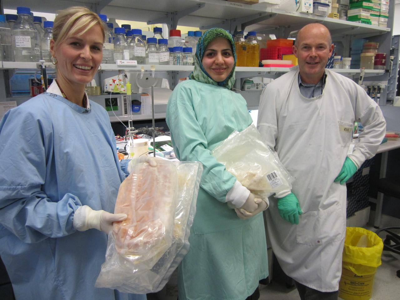 Dr. Marit Kramski (left) and colleagues Behnaz Heydarchi and Rob Center, with bags of frozen HIV-fighting milk (Photo: Fresh Science)