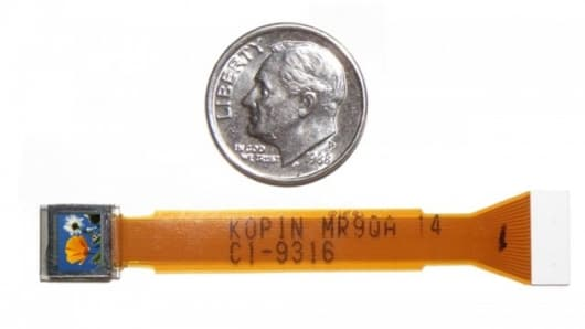 Kopin's tiny CyberDisplay VGA display compared to the size of a U.S. dime