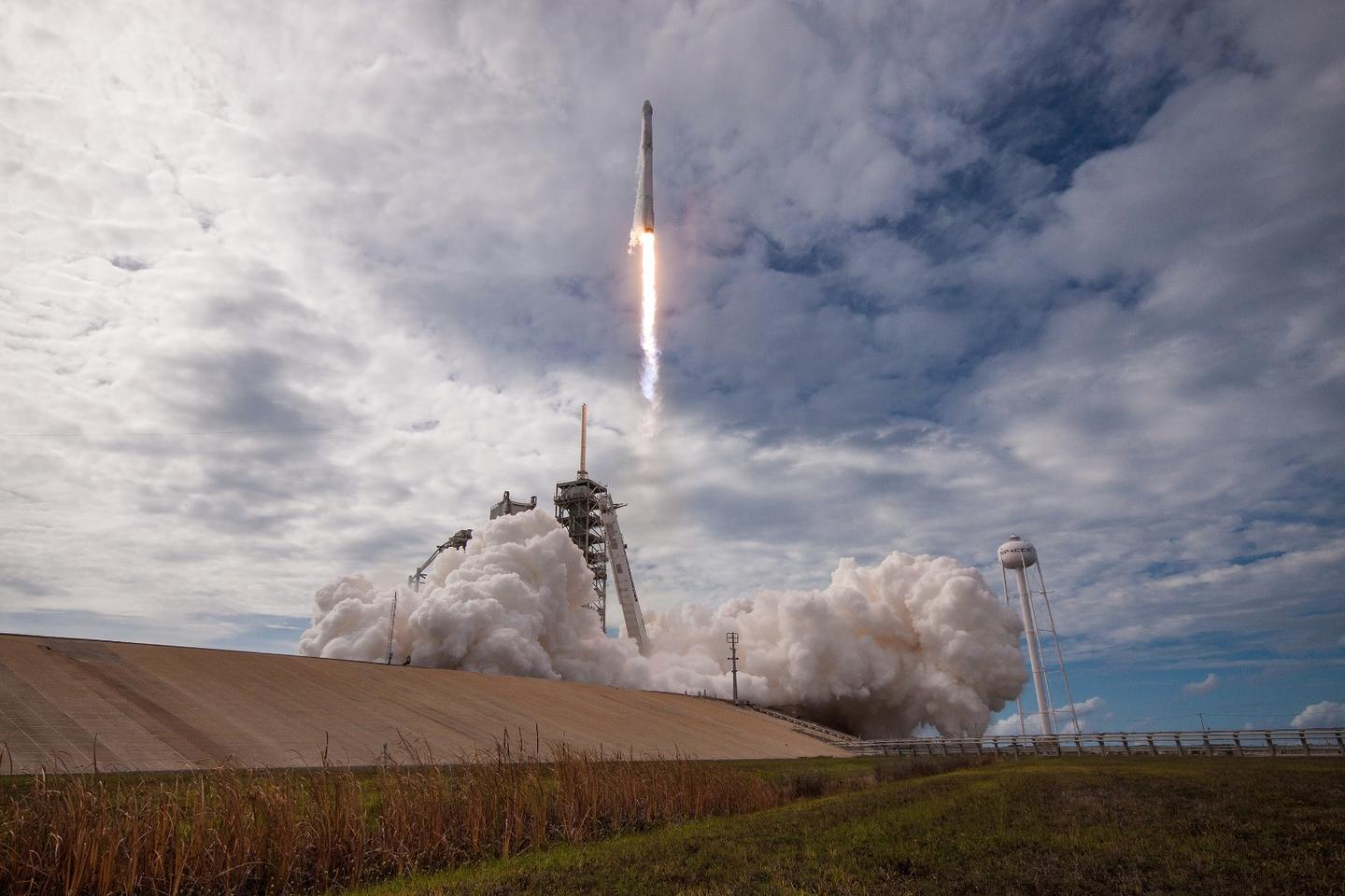 A re-used Dragon capsule lifts off from Cape Canaveral