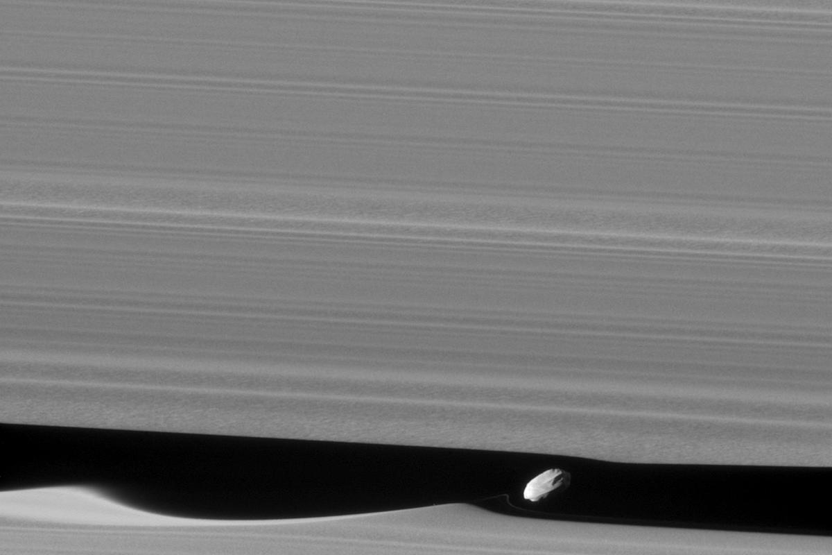 A closer look at Daphnis' effect on Saturn's rings