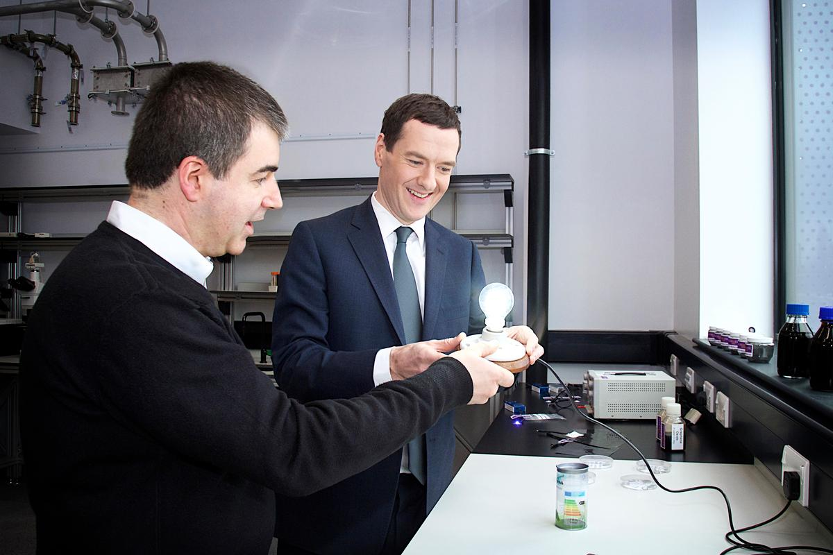 Sir Kostya Novoselov (left, one of the two graphene Nobel laureates) and Chancellor George Osborne with the graphene lightbulb (Photo: The University of Manchester)