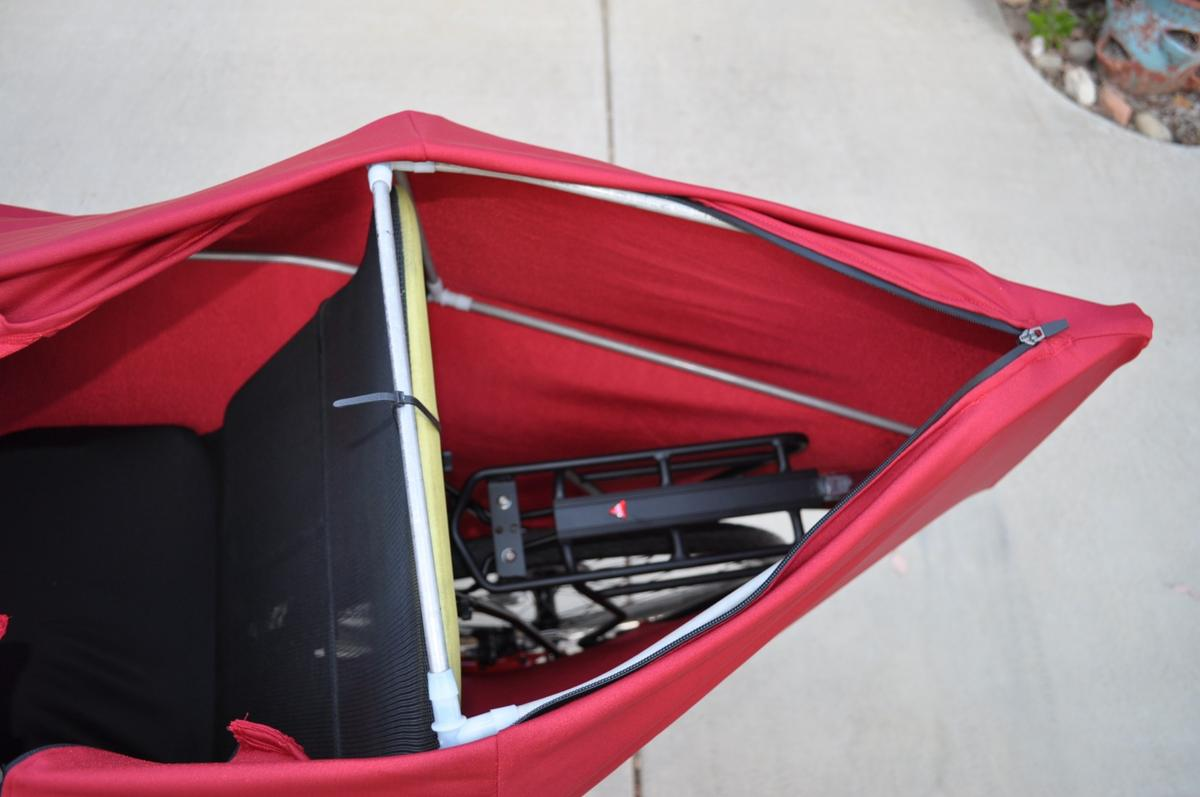A zipper on the back of the Lightning F-22's shell allows for access to a nylon seat-back bag featuring two small pockets and a single large one, along with an Axiom aluminum alloy cargo rack