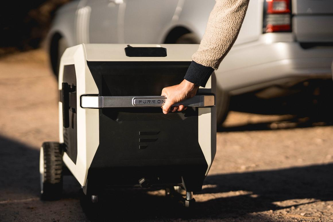 The Furrion rolls to camp with a collapsible handle and grippy wheels