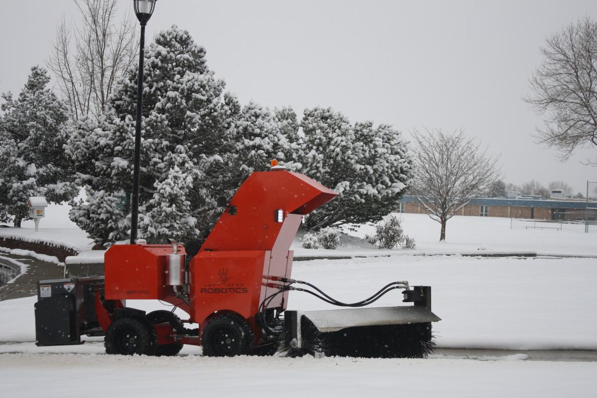 The SnowBot Pro is powered by a gas engine, and automatically avoids obstacles