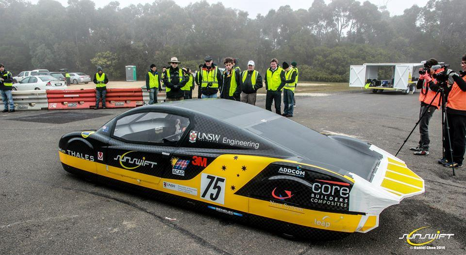 Members of the Sunswift team and the eVe after it's record-breaking run (Photo: Sunswift / Daniel Chen)